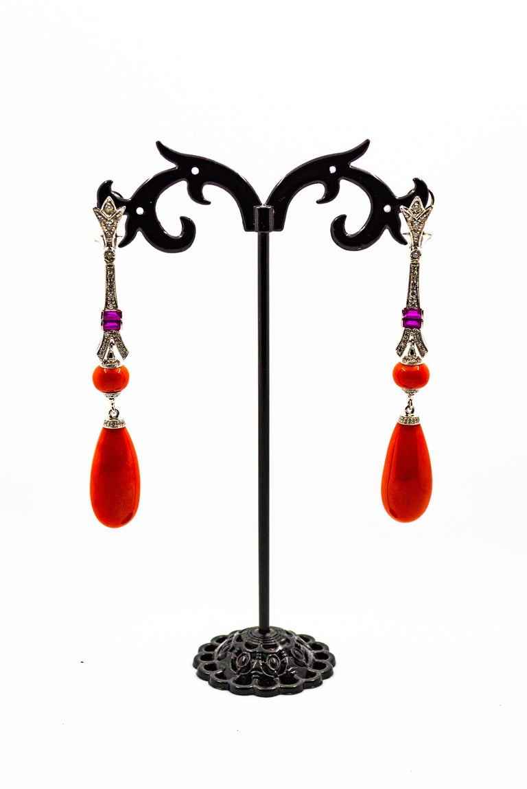 These Clip-On Earrings are made of 9K White Gold. These Earrings have 0.90 Carats of White Diamonds. These Earrings have Mediterranean (Sardinia, Italy) Red Coral and Amethyst. All our Earrings have pins for pierced ears but we can change the