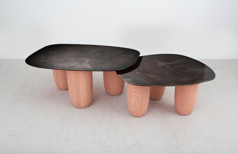 Our medium version Sumo table was introduced at Design Miami 2020 paired with its small counterpart as shown. The design was influenced by Japanese minimalist aesthetics. Resembling a softened stone as well as a likeness to the strength and stance
