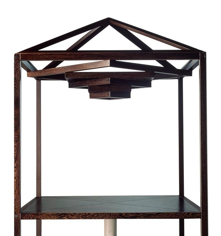 This imposing table will make a statement both in a Classic and contemporary decor. The frame and top are made in wood, showing the natural veins that make each piece a one-of-a-kind design object, and create a magnificent canopy above. The wood can