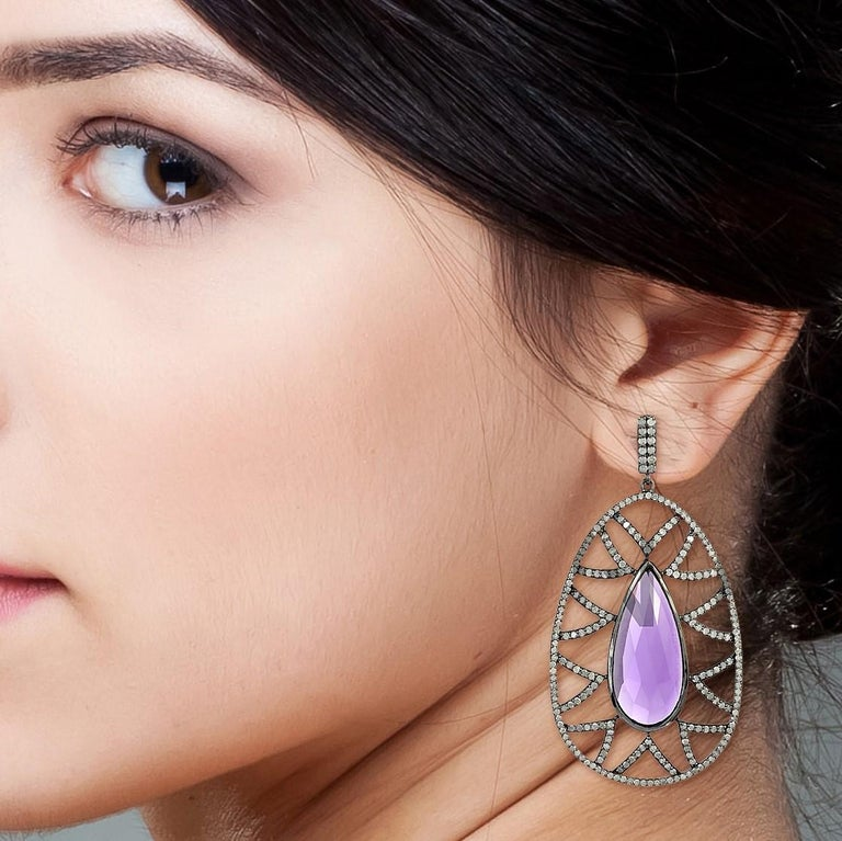 Bold and distinctive, these statement-making Bora Bora earrings are stunningly set in semi precious gems. The drops of cabochon turquoise are framed by diamond pave arches. The negative space accentuates the main stone to create a dazzling dangle.