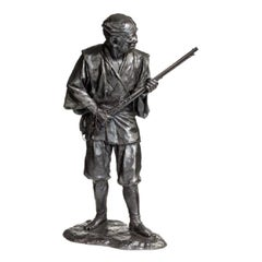 Meiji Period Bronze of a Huntsman Carrying a Gun