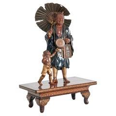 Meiji Period Bronze of an Oni Holding a Parasol