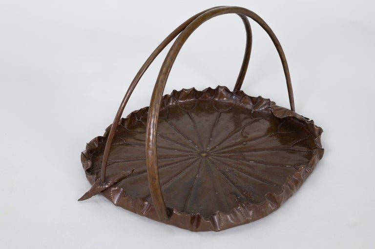 Meiji period copper lotus leaf tray. Meiji period (1868-1912) copper tray in the shape of a lotus leaf with hand tooled details, and a handle in the shape of two lotus stems with the recognizable hollow stem details that can be seen from underneath.