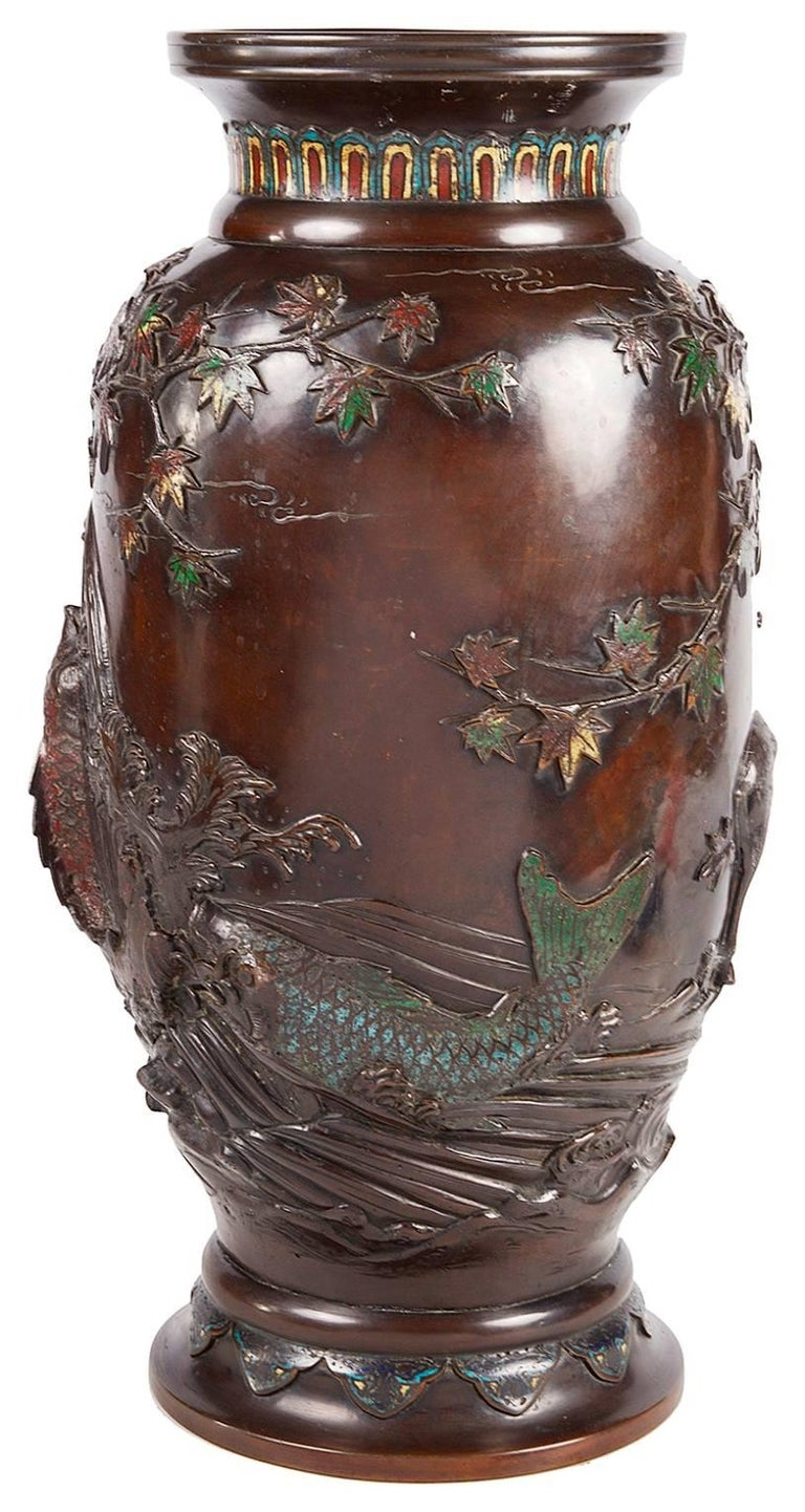 A very impressive Japanese bronze and cloisonne enamel vase having raised decoration depicting a carp in the river, with a deer under a tree.