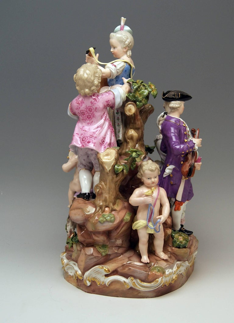 Meissen stunning tall figurine group: the bucolic festival  (seven figurines)  MEASURES: height:  14.56 inches  diameter of base: 7.87 inches  Manufactory: Meissen Hallmarked:  Blue Meissen Sword Mark  (glazed bottom) model number C 59 / former's
