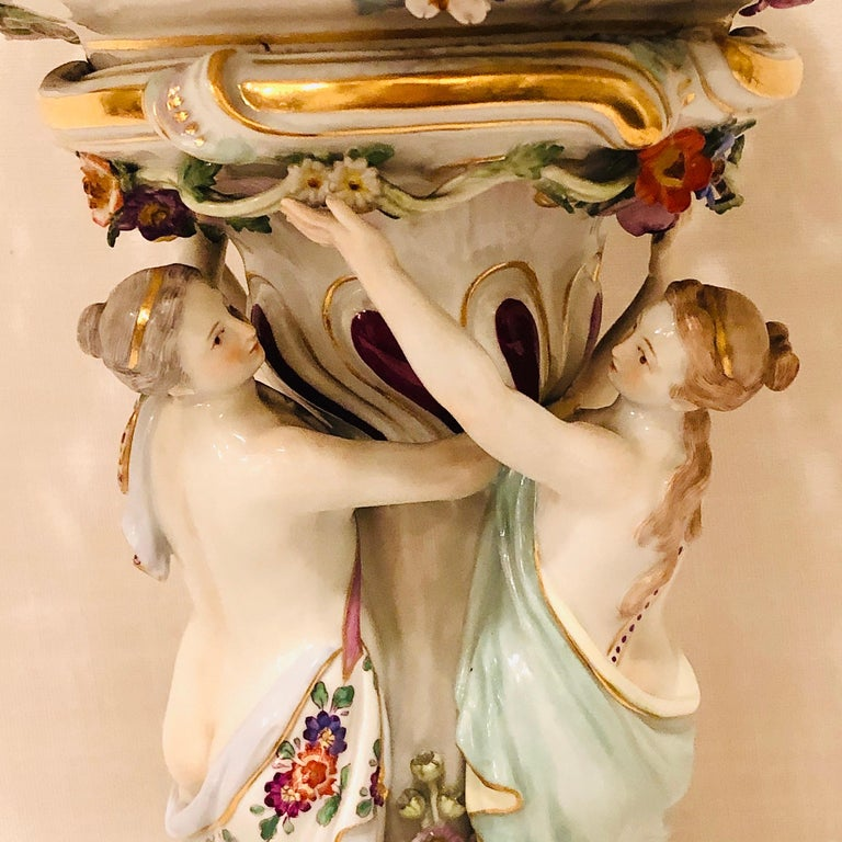 Meissen centerpiece of the three graces or charities dancing in a circle. These three graces are from Greek mythology and they represent charm, beauty, nature, good will, fertility and human creativity. These beautiful ladies are eternally young and