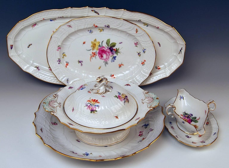 We invite you here to look at a Splendid Meissen dinner set for six persons consisting of 23 pieces: White porcelain, multicolored painted with nicest flower pattern, golden painted edges existing. Decoration type and form: Neubrandenstein-relief (=
