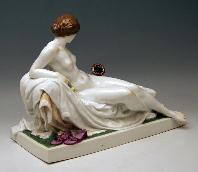 Meissen gorgeous figurine of nude lady with mirror / created by Robert Ockelmann    Manufactory: Meissen Hallmarked: Blue Meissen Sword Mark (underglazed) First quality Dating: made circa 1903-1905  Material: porcelain, glossy finish,
