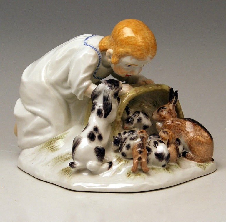 Meissen most lovely figurine: Girl with rabbits  Measures / Dimensions: Height 5.11 inches / 13.0 cm  Width 6.29 inches / 16.0 cm Depth 4.84 inches / 12.3 cm  Manufactory: Meissen Hallmarked: Blue Meissen Sword Mark (glazed bottom) model