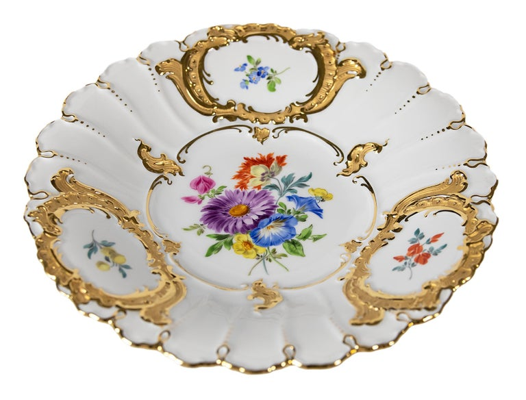 Meissen Porcelain plate with hand painted floral motives and gold decor.