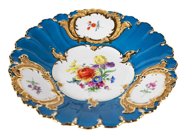 Meissen Porcelain turquoise color plate decorated with hand painted floral motives and gold decor.
