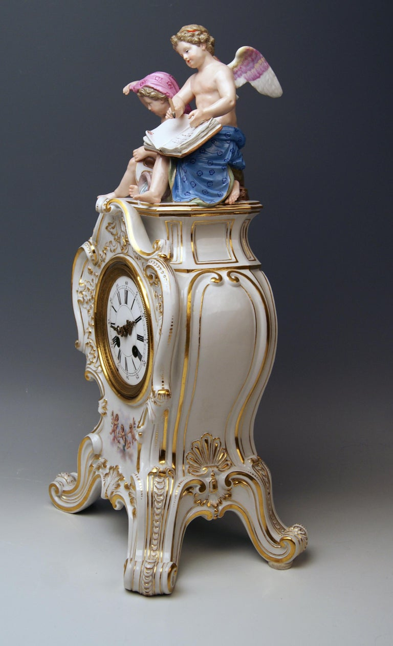 Meissen stunning table clock: Sculptured Figurines  =  Cherubs / Cupids on top piece   (Allegory of Water) The details are excellently scupltured = finest modelling !  Hallmarked: Meissen Blue Sword Mark with Pommels on Hilts  (glazed bottom) Style: