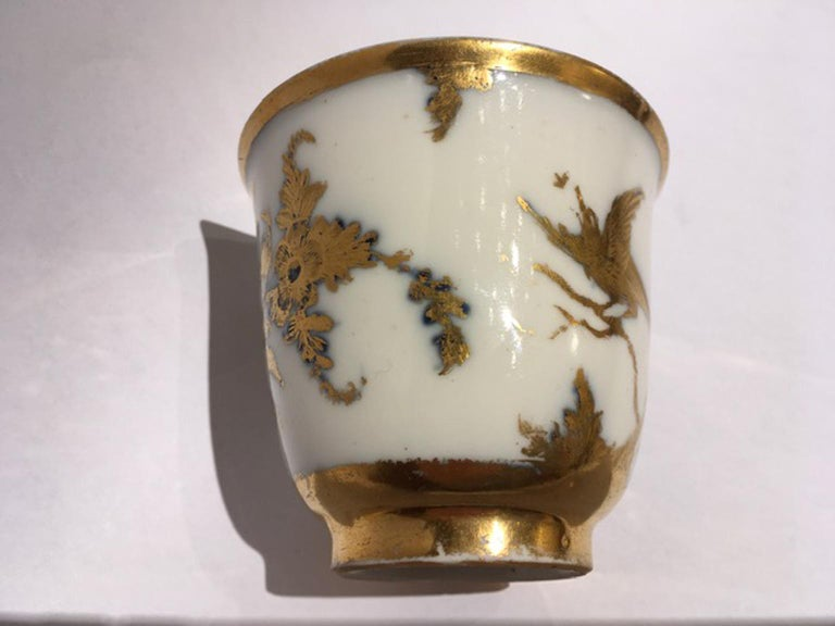 This is a small masterpiece of craftsmanship: the fine porcelain is designed in gold with floral and natural scenes, rich in detail. A piece for refined collectors or useful to start a collection  Marked on the back. With certificate of