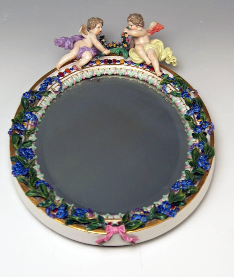 Meissen wall mirror with cherubs  Manufactory:Meissen Dating: 19th century / made circa 1870 Material: white porcelain , glossy finish Technique: porcelain (modelled and fired) / multicolored painted  Item type: Meissen stunning wall