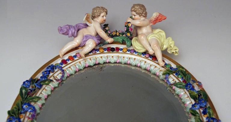 Rococo Meissen Oval Wall Mirror Pair of Cherubs Vintage, circa 1870 For Sale