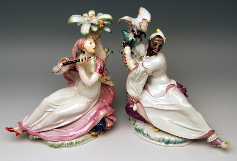 Meissen most remarkable pair of figurines: Designed by Paul Scheurich (1883-1945) Oriental woman with flute / modelled 1926 Black man with cockatoo / modelled 1922.  Size: Female flute player: Height 8.66 inches / 22.0 cm Width 7.87 inches /