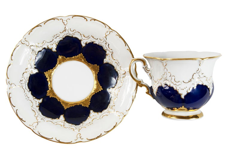 Meissen Porcelain coffee cup with saucer decorated with cobalt and gold. Measures: Cup: 7.5 (H) x 10 cm Saucer: 16.5 cm.