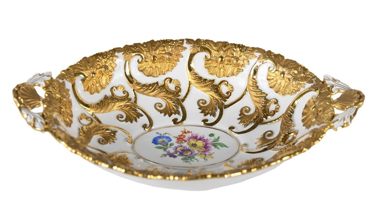 Meissen Porcelain deep cabinet plate or bowl with handles. This piece is hand painted with floral motives and richly decorated with gold.