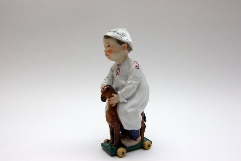 Old beautiful Meissen porcelain figure Hentschelkind child on horse.  The porcelain figure is from 1905 and the designer is Konrad Hentschel.  The porcelain figure is in a good condition it haves only a little restoration at a