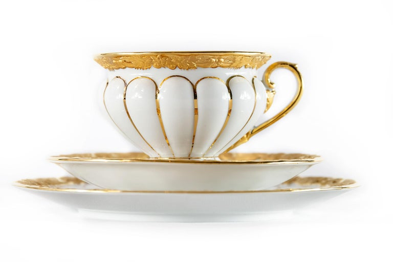 Meissen porcelain tea cup with saucer and dessert plate all richly decorated with gold. Measures: Cup: 7.2 (H) x 10 cm Saucer: 15.5 cm Dessert plate: 19.5 cm.