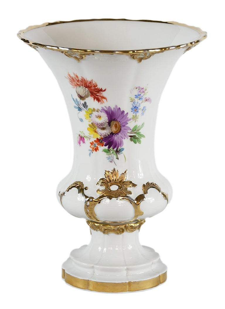 Meissen Porcelain vase with hand painted flowers decorated with gold ornaments.