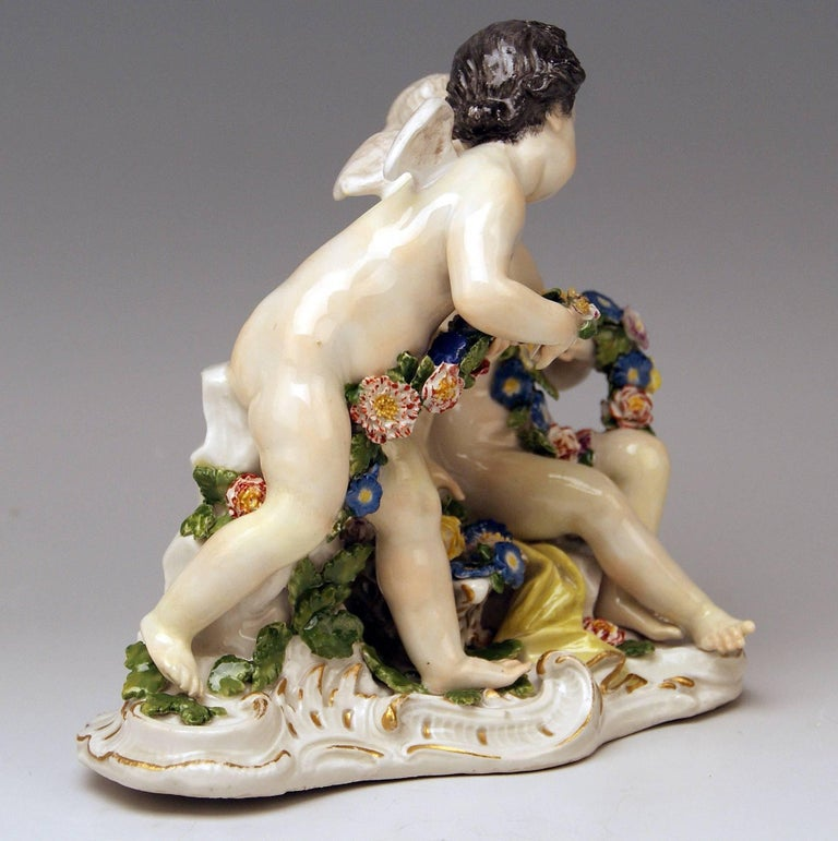 Meissen lovely figurines of stunning appearance: cherubs with flowers model 2372  SIZE: height:    6.49  inches  (= 16.5 cm) width:     6.37  inches   (= 16.2 cm) depth:    3.54  inches    (= 9.0 cm)  Manufactory: Meissen Hallmarked: Blue Meissen