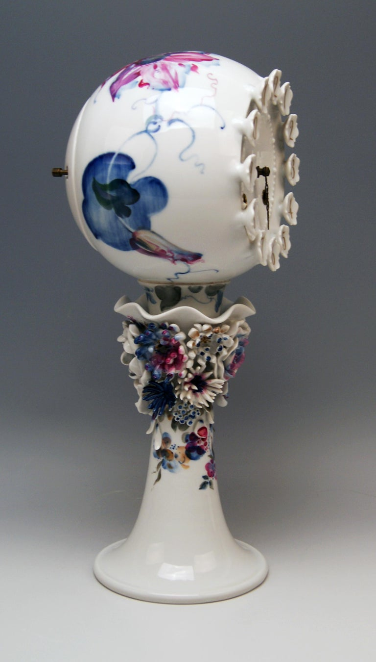 Meissen gorgeous rare table clock of finest manufacturing quality. Measures: height 38.5 cm (= 15.15 inches) diameter 17.5 cm (= 6.88 inches)  Manufactory: Meissen Hallmarked: Blue Meissen Sword Mark (underglazed) First quality Model 60886 /