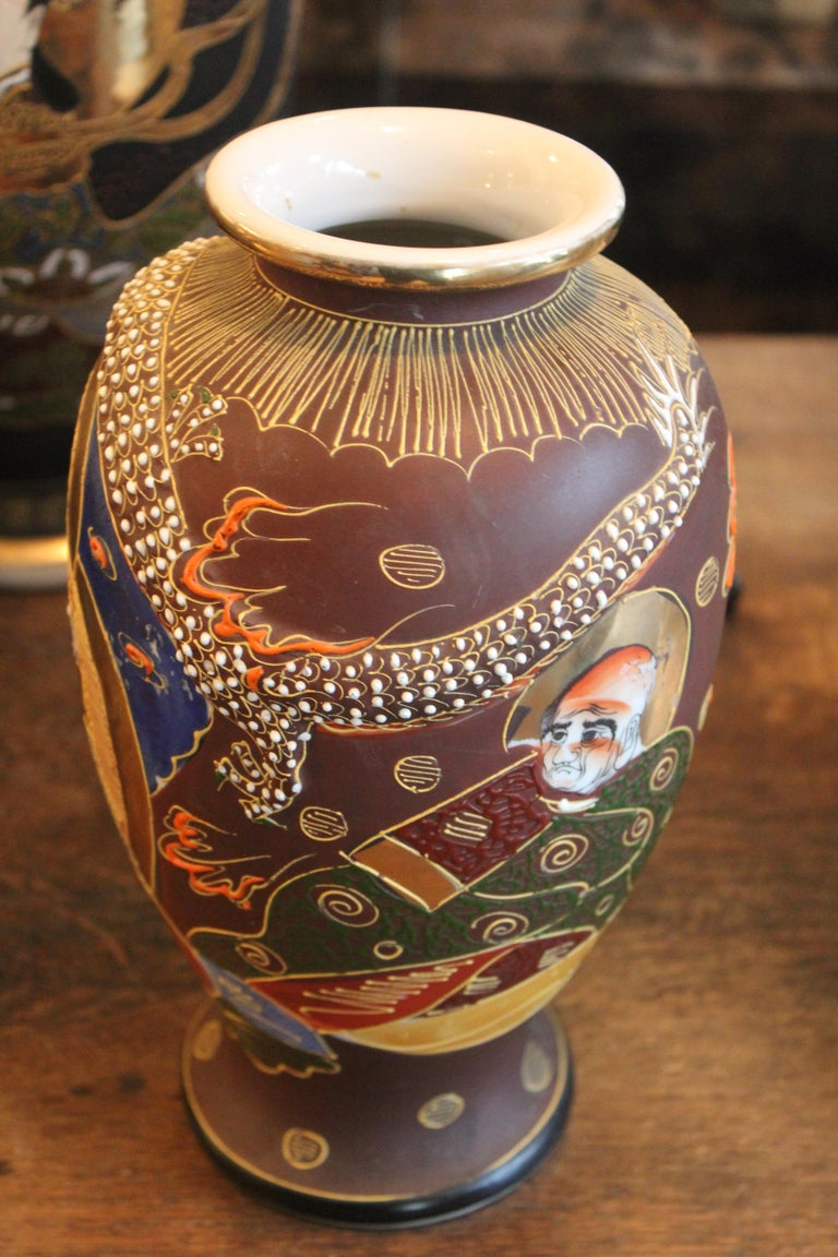 """Mejiiearly 20th century Satsuma vase   Our 10 """"tall by 6"""" wide (+/-) Mejii early 20th century vase has the most wonderfully detailed raised elements, see photo. It is stamped made in Japan denotes 20th century dating. Please view all photos and"""