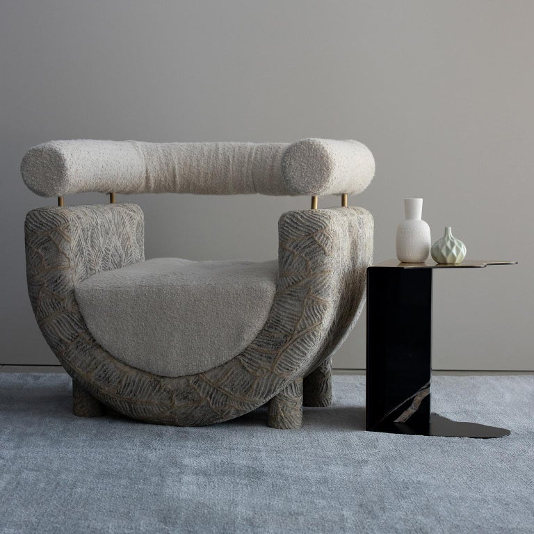 Wooden armchair with semicircular structure upholstered in beige jacquard velvet with a leaf pattern. Seat cushion with a blind tufting effect and rolled armrest, both upholstered in pearl cotton-linen blend bouclé fabric. Metal armrest support in