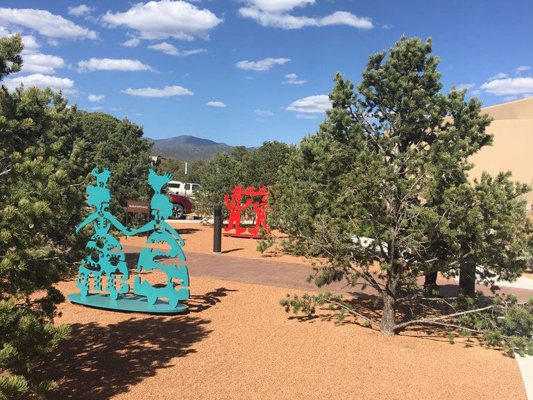 Making New Friends, teal aluminum sculpture Korean & Navajo Women outdoor heart - Contemporary Sculpture by Melanie A. Yazzie