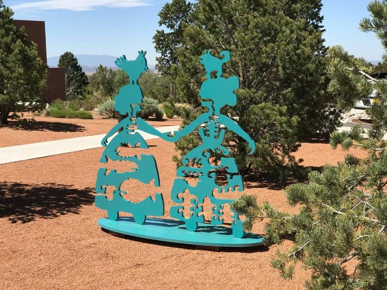 Making New Friends, teal aluminum sculpture Korean & Navajo Women outdoor heart - Blue Figurative Sculpture by Melanie A. Yazzie