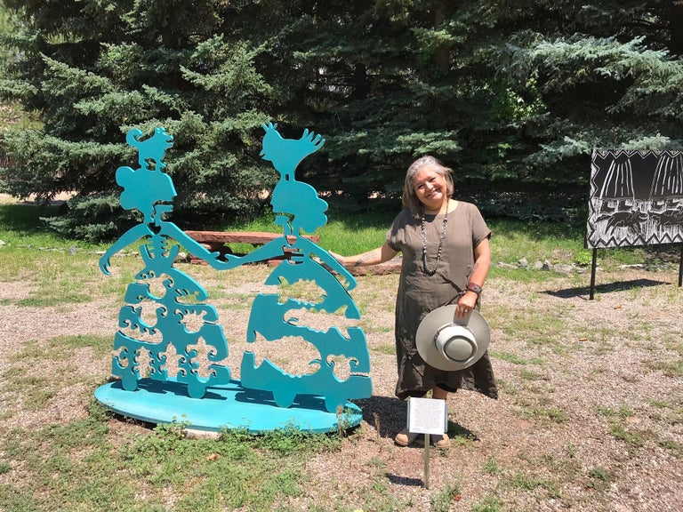 Making New Friends, teal aluminum sculpture Korean & Navajo Women outdoor heart  New sculpture featured in the exhibit for Melanie Yazzie at the Wheelwright Museum in Santa Fe, New Mexico
