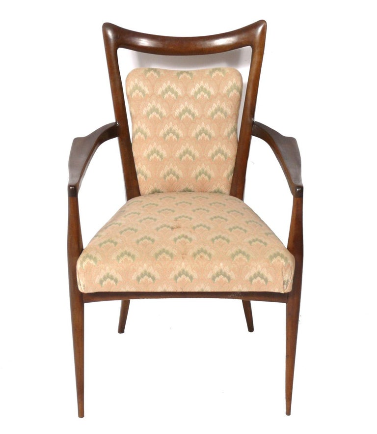 Italian modern dining chairs, designed by Melchiorre Bega, Italian, circa 1950s. These chairs are currently being refinished and reupholstered. The price noted below includes refinishing in your choice of color and re-upholstery in your fabric.