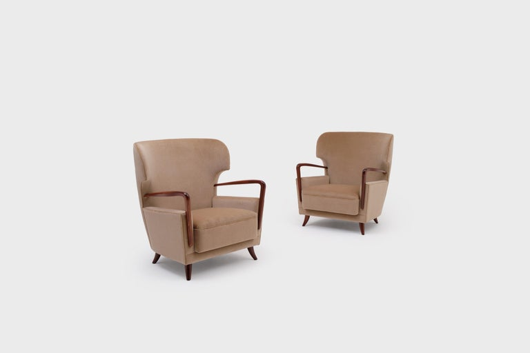 Italian Melchiorre Bega Wingback Armchairs, Italy, 1950s For Sale