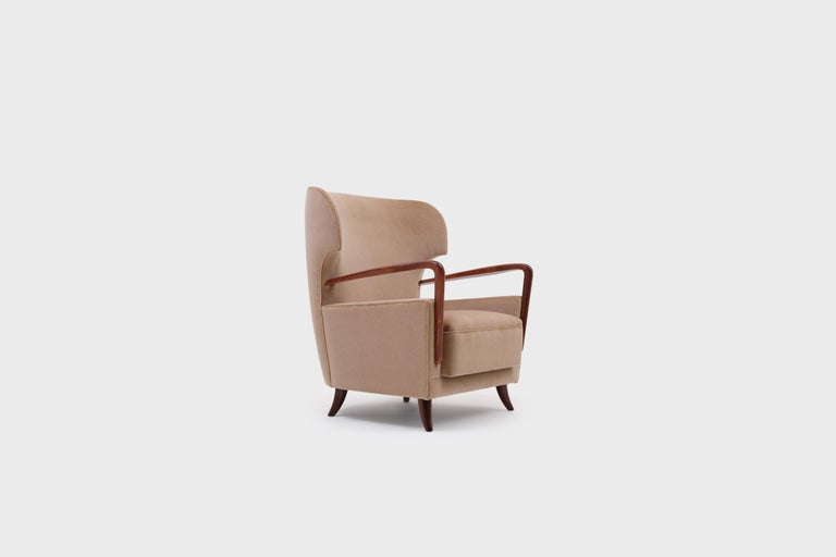 20th Century Melchiorre Bega Wingback Armchairs, Italy, 1950s For Sale