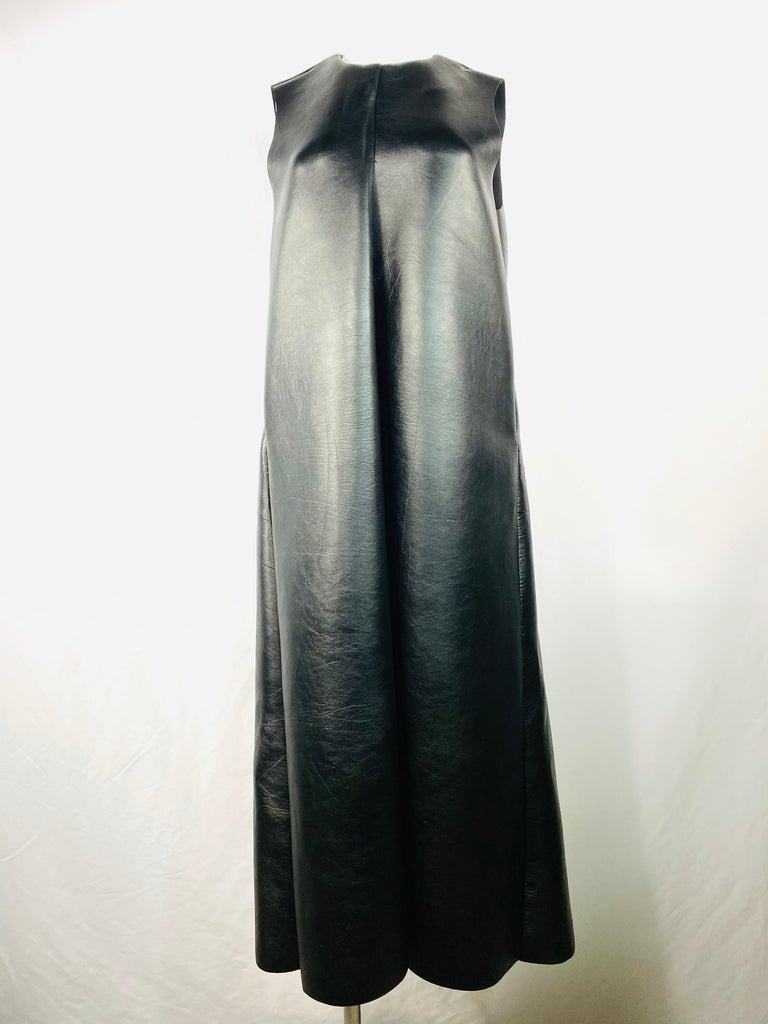 Product details:  Featuring flack faux leather, sleeveless, crew neck, pocket on each side, rear zip closure, maxi dress.  Size M. Made in USA.