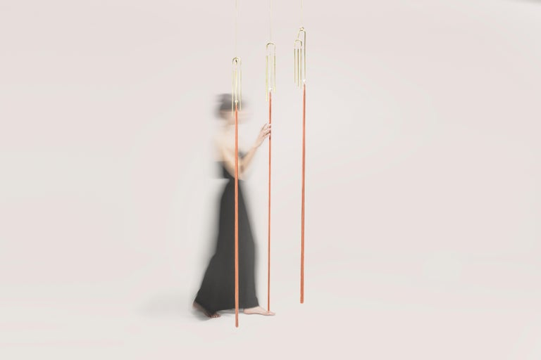 Designed by Agustina Bottoni Handcrafted in Italy Materials: solid brass with satin finish, rayon fringes Size: 150cm x 60cm Chain length: 150cm / 60  Melodicware explore the auditory experience of objects.  These items contains brass chimes