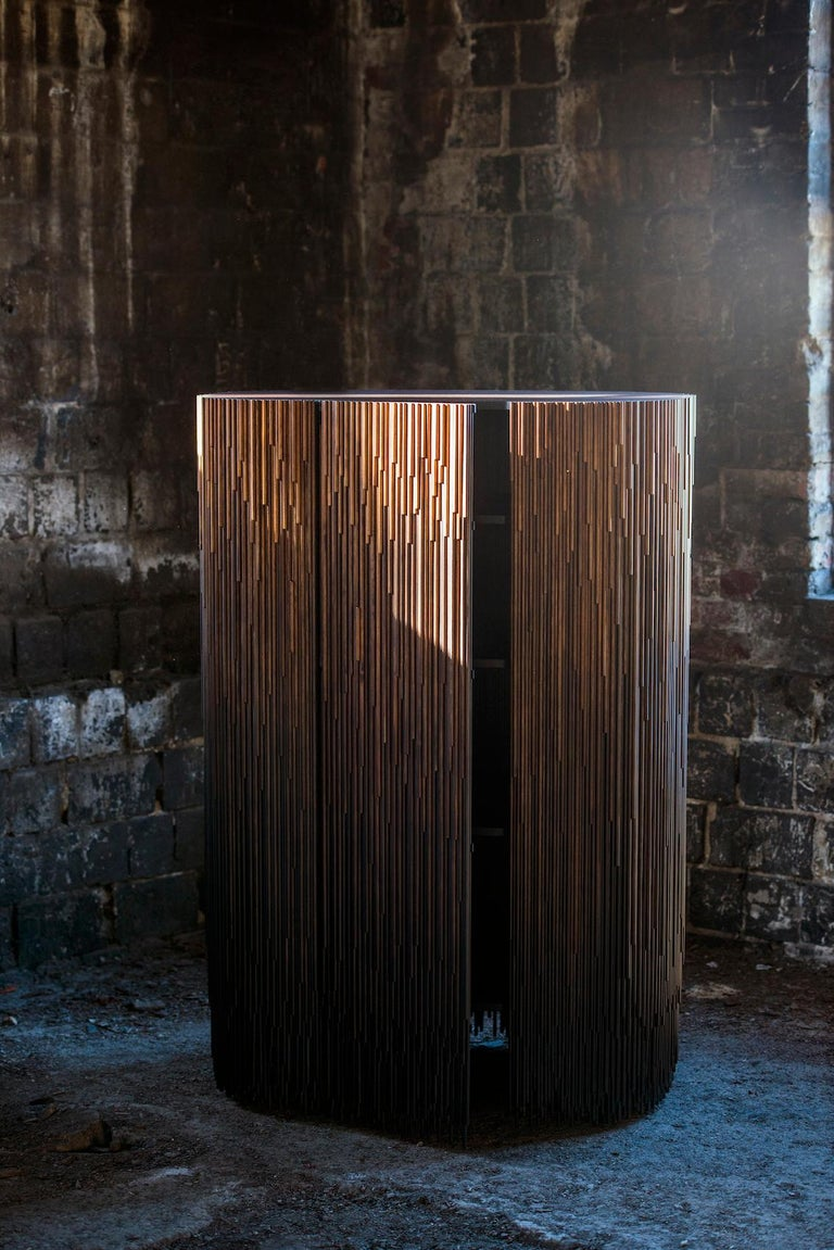 In the MELT cabinets industrially treated pine transforms into an unique art composition. The cabinet has been inspired by metamorphosis of the movement of water. By melting the ice again becomes liquid like rain.  Surface of the cabinets is built
