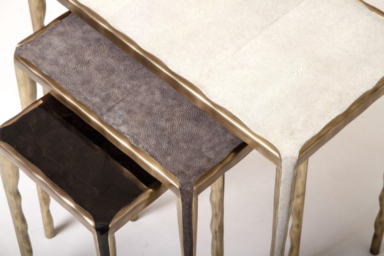 The melting nesting side table set of 3, are the perfect accent pieces for any living space. These are sold as a set of 3 to create elegant and geometric shapes, but one can purchase the tables on their own. The large and medium size are inlaid in