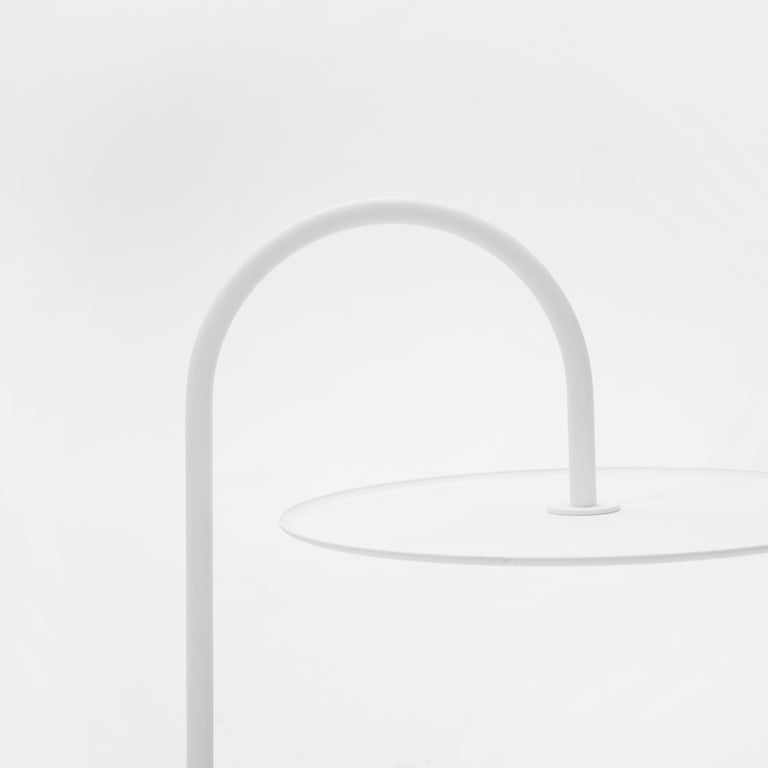 MELT is a collection of modern side coffee tables. The most unusual and characteristic is its tabletop, which is suspended from a curved leg. There are very few tables with such a design feature. The table seems to levitate and support your