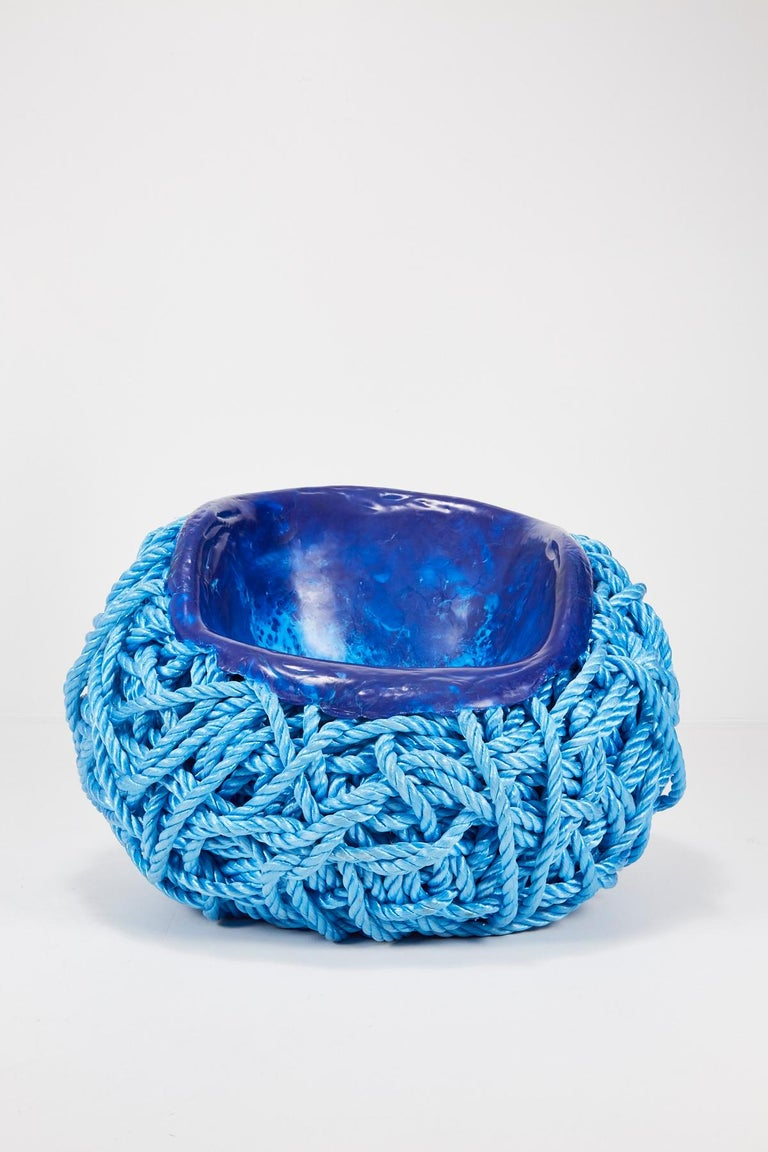 Meltdown chair: PP rope blue is created by heating and pressing a seat-shaped former into a ball of polypropylene rope (or nautical rope as used on boats). The rope begins to liquefy as it comes into contact with the heated former and, as it cools,
