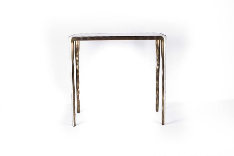The Melting Nesting Side Table in Large is part of a series of nesting side tables (sold separately) . One can purchase the tables on their own or buy them as a set to create elegant & geometric shapes. This piece is inlaid in mother of pearl and