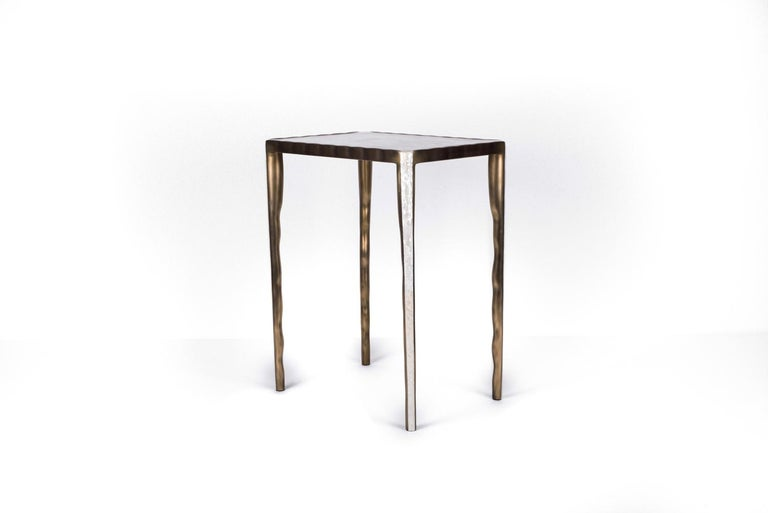 The melting nesting side table in medium is part of a series of nesting side tables (sold separately). One can purchase the tables on their own or buy them as a set to create elegant and geometric shapes. This piece is inlaid in mother of pearl and