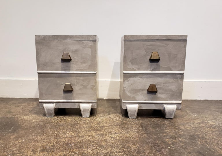 United Furniture nightstands refinished in a faux concrete finish. Unique trapezoidal brass pulls. Very 1980s Memphis Group.