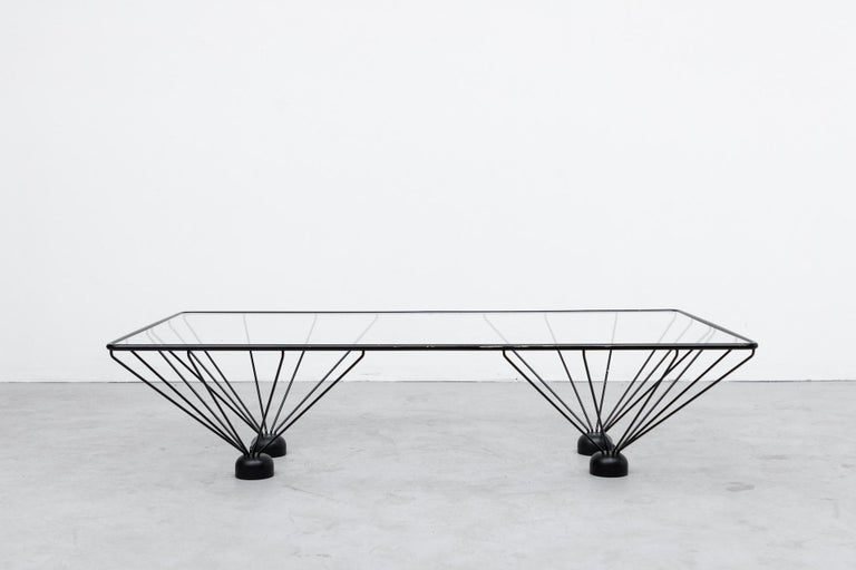 Awesome Paolo Piva inspired rectangle coffee table with black enameled metal frame and oversized weighted feet. In original condition with wear and scratching consistent with age and use. Other Piva style tables also available listed separately.