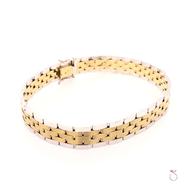 Men's 14K yellow and white gold jubilee link bracelet. This stunning men's bracelet features a beautiful geometric Jubilee design. This Italian made bracelet is very well crafted in 14K yellow and white gold. The yellow gold center links have a