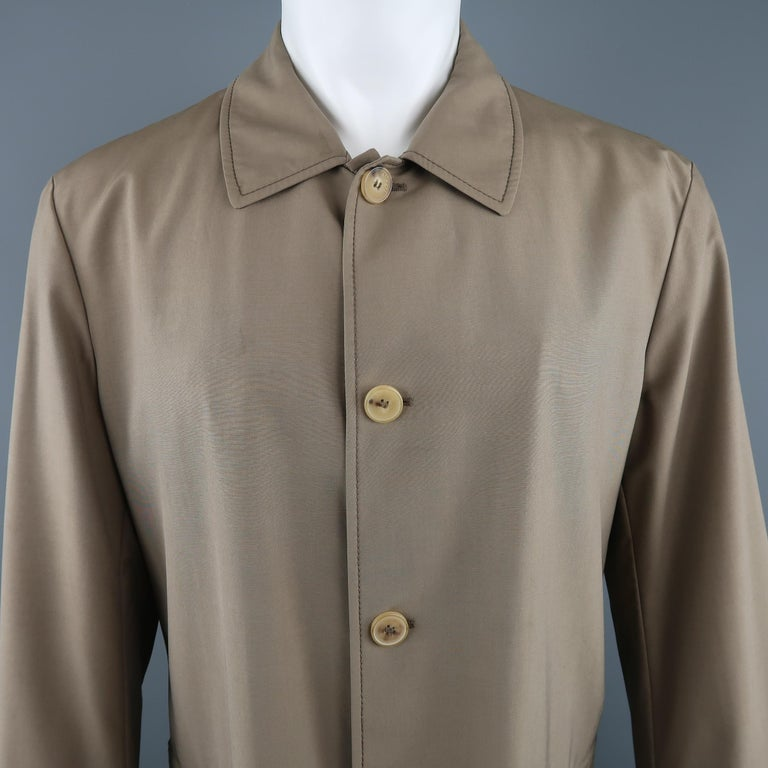 ALLEGRI car coat comes in dark khaki wool blend fabric with a pointed collar, button up front, tab cuffs, and zip pockets. Minor mark on chest. As-is.  Made in Italy.   Good Pre-Owned Condition. Marked: IT 50   Measurements:   Shoulder: 19