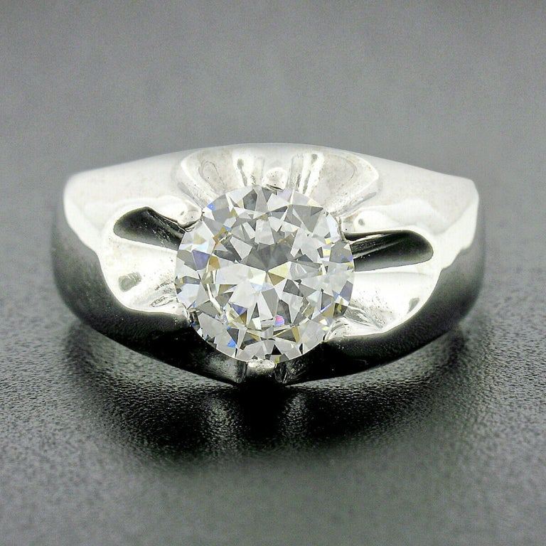 This breathtaking antique men's gypsy ring was crafted from solid 14k white gold. The old round cut diamond solitaire is GIA certified, displaying absolutely amazing amount of brilliance with eye-catching fiery effects and shows a nice large size,