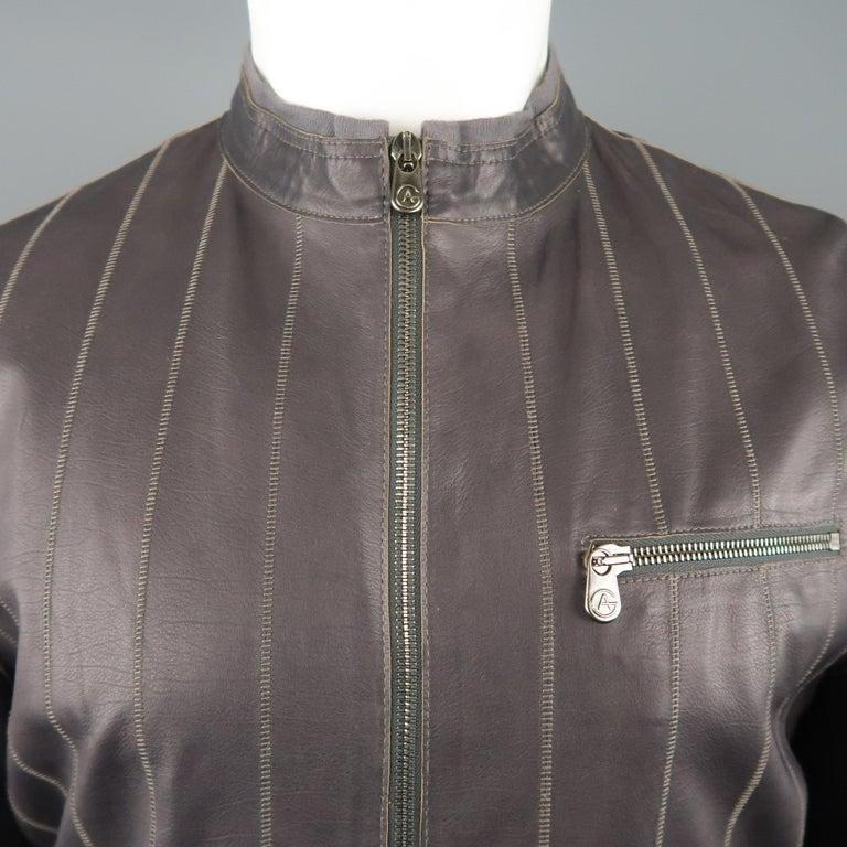 ARMANI COLLEZIONI motorcycle style jacket comes in muted eggplant purple leather with stitched stripe pattern, band collar with knit trim, zip cuffs, and zip pockets.   Excellent Pre-Owned Condition. Marked: 40   Measurements:   Shoulder: 18
