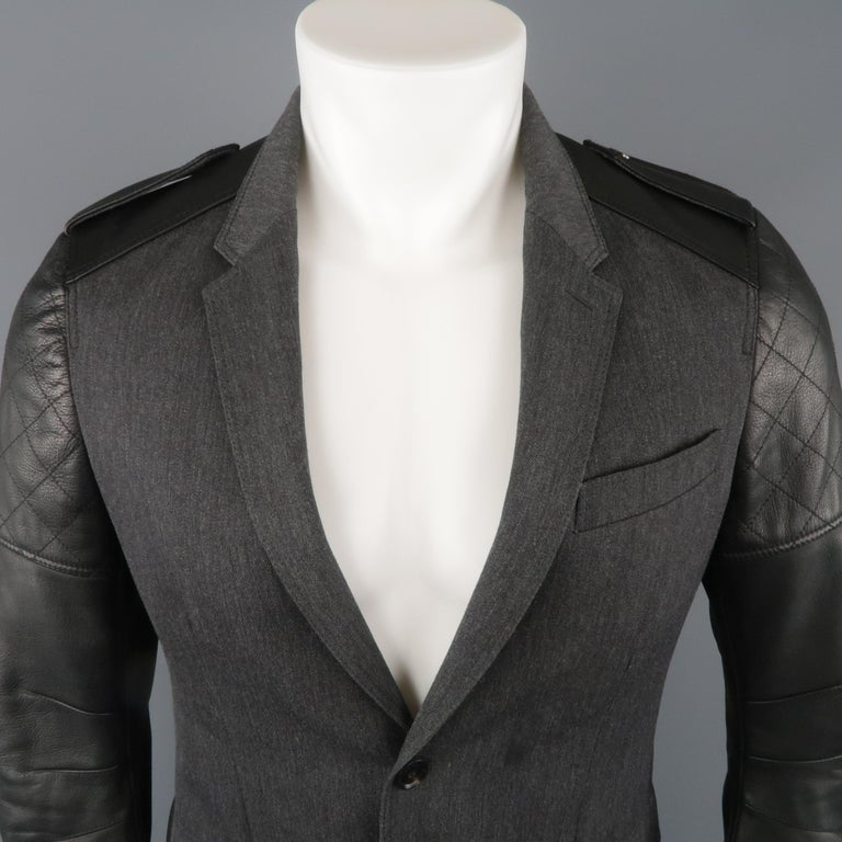 BELSTAFF sport coat jacket comes in gray wool twill with a notch lapel, single breasted two button front, flap snap pockets, and leather biker jacket sleeves with epaulets. Made in Italy.   New with Tags. Marked: IT 48   Measurements:   Shoulder: 16